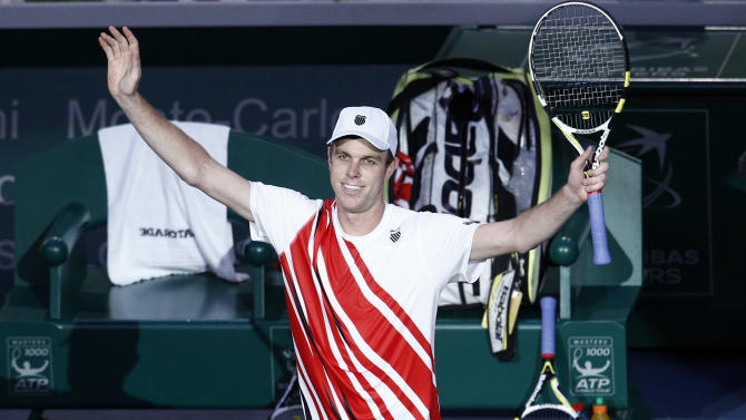 Sam Querrey of the U.S. celebrates after defeating Novak Djokovic of Serbia at the Paris Tennis Masters tournament, Wednesday, Oct. 31, 2012. (AP Photo/Christophe Ena)