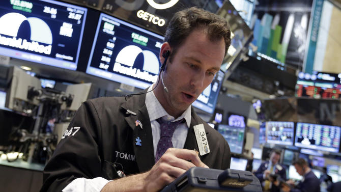 Trader Thomas Cicciari works on the floor of the New York Stock Exchange Tuesday, May 7, 2013. The Dow Jones industrial average punched through another milestone Tuesday: its first close above 15,000. (AP Photo/Richard Drew)