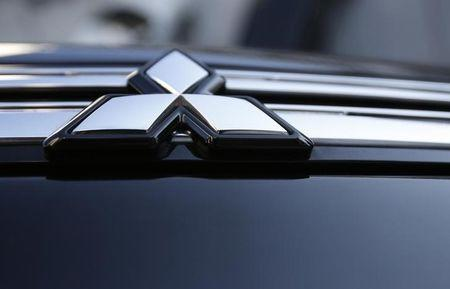 The logo of Mitsubishi Motors is seen on the front part of the company's car at the company showroom in Tokyo