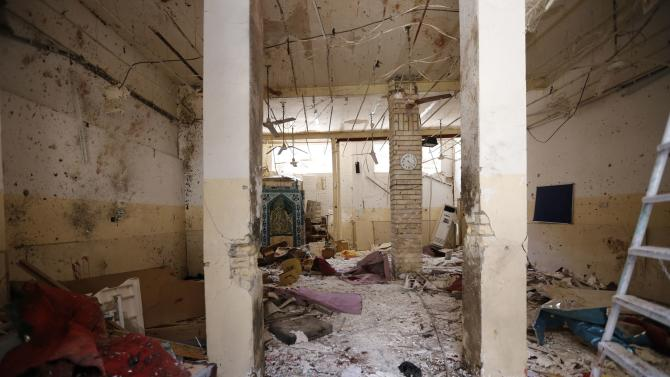 Debris lays strewn at the site of a bomb attack inside a Shi'ite mosque in Baghdad