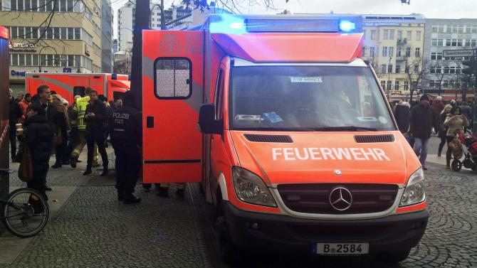 Ambulances are seen next to the luxury KaDeWe department store after a heist in Berlin