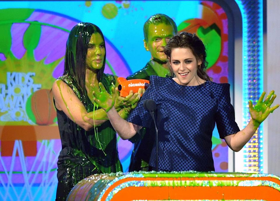 "Kristen Stewart accepts the award for favorite movie actress for ""The Twilight Saga: Breaking Dawn Part 2"" at the 26th annual Nickelodeon's Kids' Choice Awards on Saturday, March 23, 2013, in Los Angeles. (Photo by John Shearer/Invision/AP)"