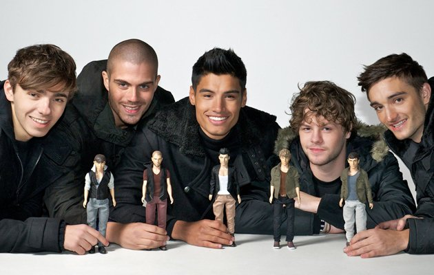 Celebrity dolls: The Wanted now come in pint-sized versions and judging by those smiles the lads seem pretty chuffed about it.