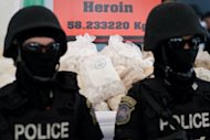 Thai police stand guard over seized drugs in Ayutthaya province in June 2012. The UN's drugs and crime office launched a new media awareness campaign on Monday to highlight the threat posed by the multi-billion dollar operations run by organised crime groups worldwide