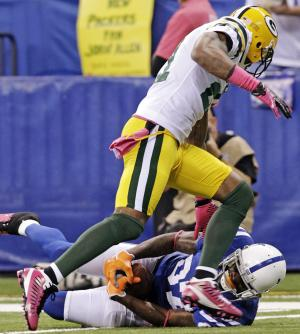 Indianapolis Colts wide receiver Reggie Wayne, bottom, makes a catch against Green Bay Packers strong safety Charles Woodson during the first half of an NFL football game in Indianapolis, Sunday, Oct. 7, 2012. The Colts won 30-27. (AP Photo/AJ Mast)