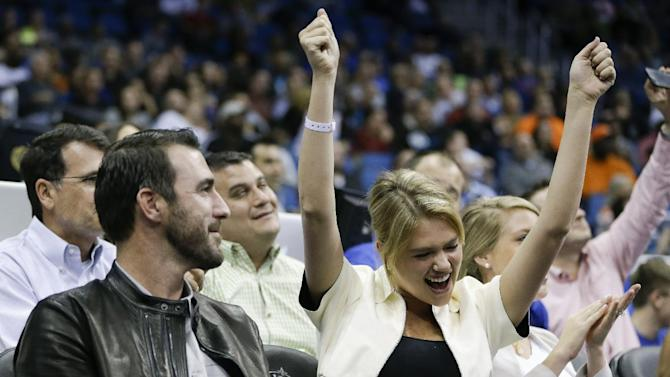 Detroit Tigers pitcher Justin Verlander, left, and model Kate Upton cheer during the first half of an NBA basketball game between the Orlando Magic and the Oklahoma City Thunder in Orlando, Fla., Friday, Feb. 7, 2014