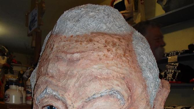 A homemade mask of West Virginia's late U.S. senator, Robert C. Byrd, sits in the store and mask museum in Helvetia, W.Va., on Saturday, Feb. 9, 2013, where revelers were celebrating the annual Fasnacht festival. (AP Photo/Vicki Smith)