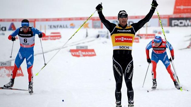 Switzerland's Dario Cologna (C) reacts after Men's 15 km classic + 15 km freestyle Skiathlon of FIS Cross Country skiing World Cup at Laura Cross Country and Biathlon Center in Russian Black Sea resort of Sochi (AFP)