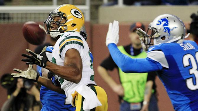 Green Bay Packers wide receiver Randall Cobb (18) catches a touchdown pass while defended by Detroit Lions free safety Ricardo Silva (39) during the fourth quarter of an NFL football game at Ford Field in Detroit, Sunday, Nov. 18, 2012. (AP Photo/Carlos Osorio)