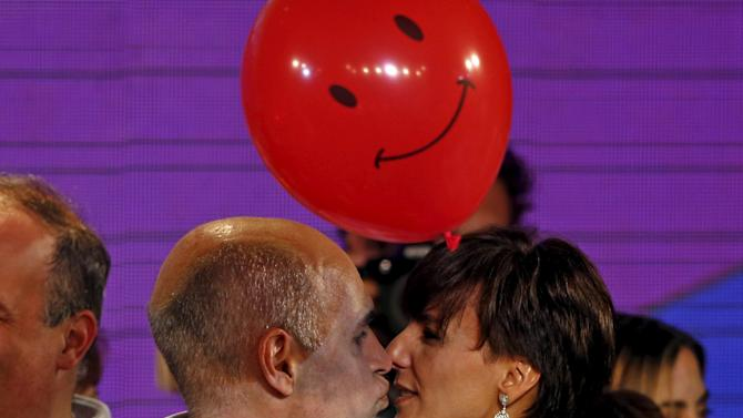 Rodriguez Larreta, mayoral race elected candidate for PRO party, kisses his wife Barbara after the election in Buenos Aires