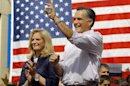 Republican presidential candidate and former Massachusetts Governor Mitt Romney, with his wife Ann at his side, is introduced at a campaign rally in Naples