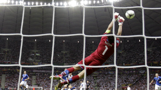 Italy goalkeeper Gianluigi Buffon dives for a save during the Euro 2012 soccer championship semifinal match between Germany and Italy in Warsaw, Poland, Thursday, June 28, 2012. (AP Photo/Frank Augstein)