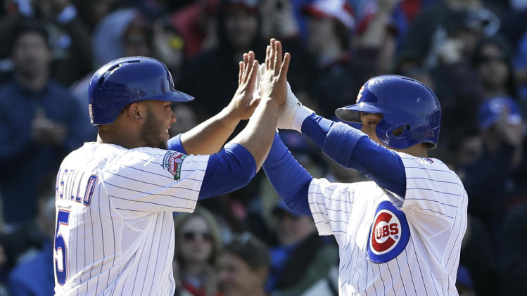 Chicago Cubs' Darwin Barney, right, celebrates with Welington Castillo after hitting a two-run home run during the sixth inning of a baseball game against the Cincinnati Reds in Chicago, Saturday, April 19, 2014. (AP Photo/Nam Y. Huh)