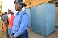 "A police officer stands guard outside a polling station in Serrekunda, southwest of the Gambian capital Banjul, on November 24, 2011. The United States expressed ""great concern"" Monday for the safety of outspoken Gambian religious leader Imam Baba Leigh, who was arrested last month and is being detained incommunicado."
