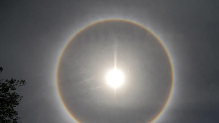 A halo, an optical phenomenon that appears around the Sun, is photographed in Medan