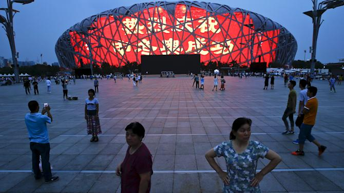 A message of congratulation is projected onto the Bird's Nest Olympic stadium as people celebrate after Beijing was chosen to host the 2022 Winter Olympics in Beijing