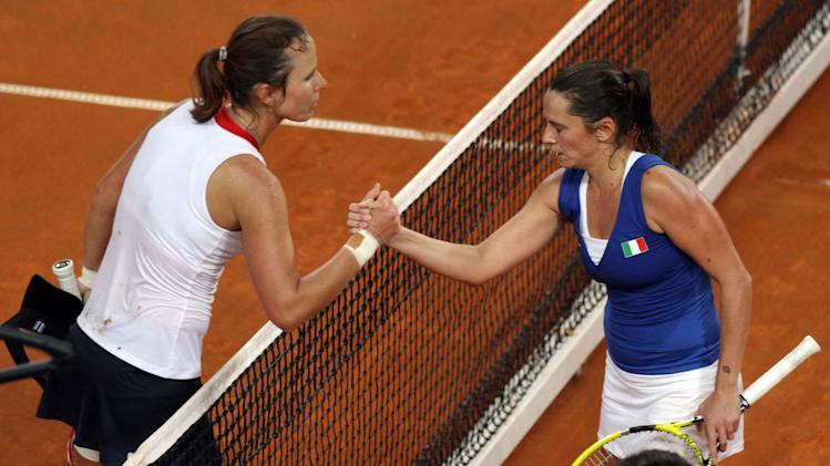 United States' Varvara Lepchenko, left, shakes hands with Italy's Roberta Vinci at the end of a World Group first round Fed Cup tennis match at the 105 stadium in Rimini, Saturday, Feb. 9, 2013. Lepchenko won 2-6, 6-4, 7-5. (AP Photo/Felice Calabro')
