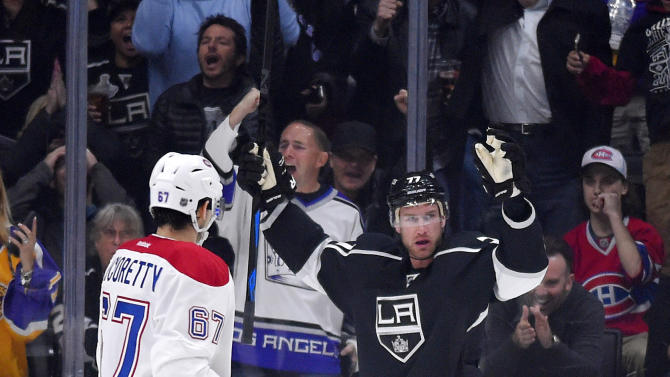 Los Angeles Kings center Jeff Carter, right, celebrates his goal as Montreal Canadiens left wing Max Pacioretty watches during the first period of an NHL hockey game, Thursday, March 5, 2015, in Los Angeles. (AP Photo/Mark J. Terrill)