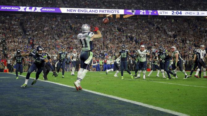 New England Patriots quarterback Brady watches as wide receiver Edelman catches a fourth quarter touchdown pass against the Seattle Seahawks during the NFL Super Bowl XLIX football game in Glendale