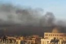 This image made from amateur video and released by Shaam News Network Wednesday, April 4, 2012, purports to show black smoke from shelling billowing into the sky air in Aleppo, Syria. Syrian troops launched a fierce assault on a Damascus suburb Thursday, days ahead of a deadline for a U.N.-brokered cease-fire, with activists describing it as one of the most violent attacks around the capital since the year-old uprising began. (AP Photo/Shaam News Network via APTN) THE ASSOCIATED PRESS CANNOT INDEPENDENTLY VERIFY THE CONTENT, DATE, LOCATION OR AUTHENTICITY OF THIS MATERIAL. TV OUT