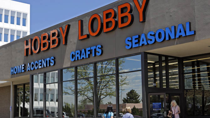 Customers are seen at a Hobby Lobby store in Denver on Wednesday, May 22, 2013.  A challenge to the federal health care law faces its most prominent test yet in a full 10th Circuit hearing in Denver on Thursday. Hobby Lobby stores is challenging a federal mandate requiring it to offer employees health coverage that includes access to the morining-after birth control pill.  The Oklahoma based arts and crafts chain says the mandate violates the religious beliefs of its owners.  (AP Photo/Ed Andrieski)
