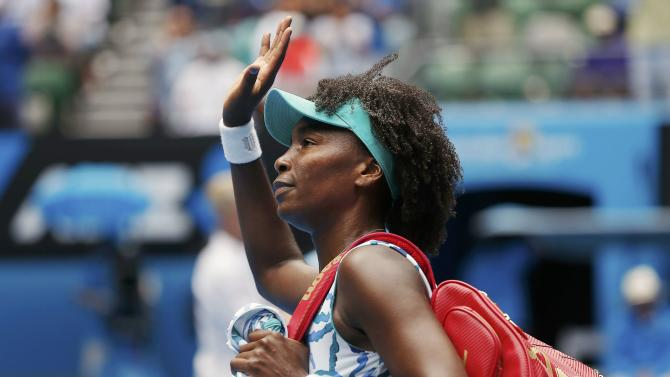 Venus of the U.S. waves after being defeated by compatriot Keys in their women's singles quarter-final match at the Australian Open 2015 tennis tournament in Melbourne
