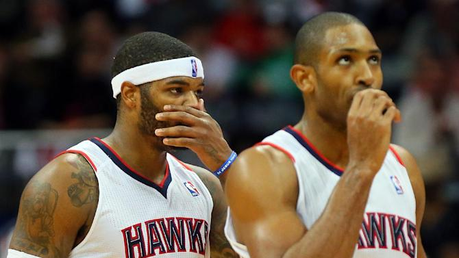 Atlanta Hawks' Josh Smith, left, and Al Horford react as the Hawks fall behind the Indiana Pacers during the first half of Game 6 of an NBA basketball first-round playoff series Friday, May 3, 2013, in Atlanta. The Pacers won 81-73 and took the series. (AP Photo/Atlanta Journal Constitution, Curtis Compton) GWINNETT OUT  MARIETTA OUT