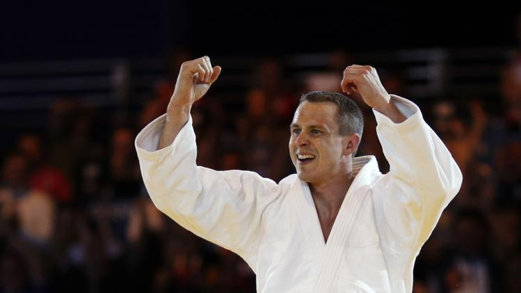 Euan Burton of Scotland reacts following his victory over Shah Hussain Shah of Pakistan in the judo -100kg gold medal contest at the 2014 Commonwealth Games in Glasgow