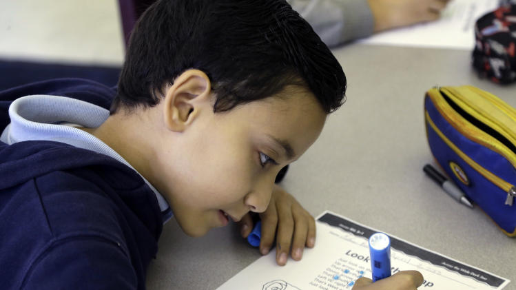 In this April 3, 2013 photo, Mathew Botros, 9, works on a lesson during an English class at the Coral Way K-8 Center, the nation's oldest bilingual school, in Miami. Students who speak a language other than English at home are one of the fastest-growing populations. (AP Photo/Lynne Sladky)
