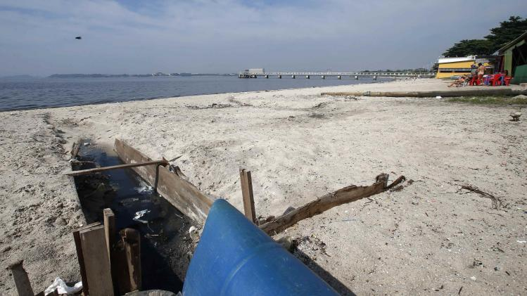 A sewage duct is seen on Galeao beach in the Guanabara Bay in Rio de Janeiro