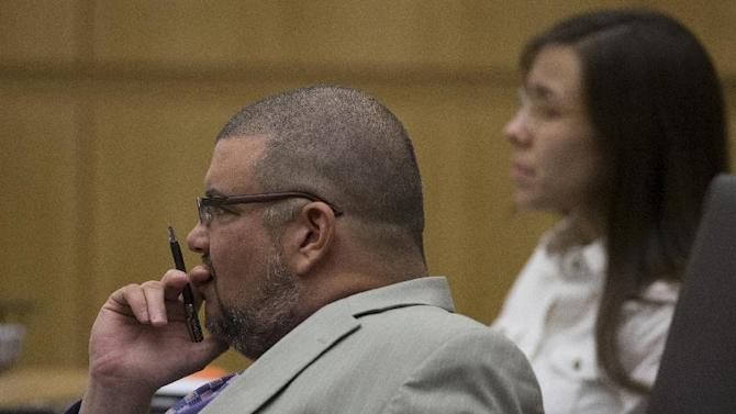 Defense attorney Kirk Nurmi, left, listens during the Jodi Arias trial at Maricopa County Superior Court in Phoenix on Thursday, April 18, 2013. Arias faces a potential death sentence if convicted of first-degree murder in Travis Alexander's June 2008 killing at his suburban Phoenix home. (AP Photo/The Arizona Republic, Mark Henle, Pool)