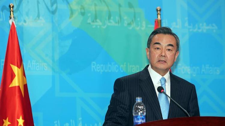 "Chinese Foreign Minister Wang Yi, pictured in Baghdad on February 23, 2014, says China will defend its  sovereignty, declaring there is ""no room for compromise"" with Japan over territory or history"