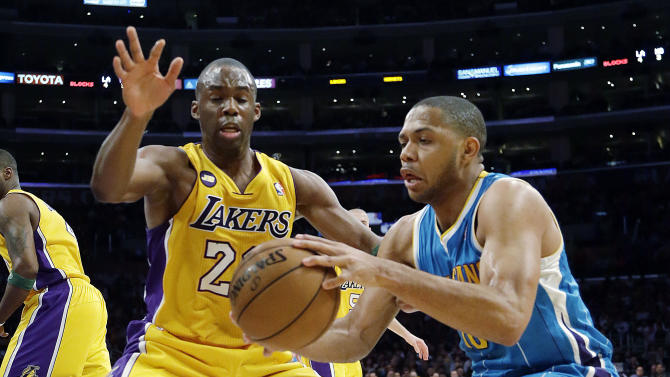 New Orleans Hornets guard Eric Gordon (10) and Los Angeles Lakers guard Jodie Meeks (20) battle in the first half of an NBA basketball game in Los Angeles Tuesday, April 9, 2013.  (AP Photo/Reed Saxon)