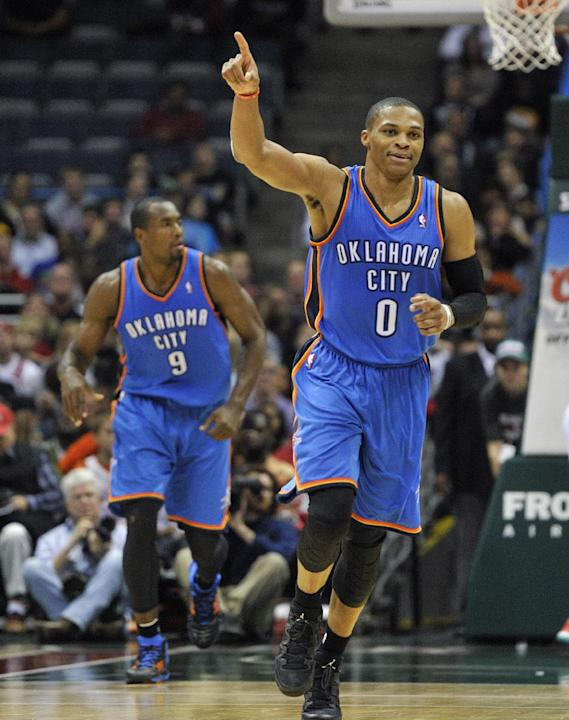 Oklahoma City Thunder's Russell Westbrook (0) celebrates a basket against the Milwaukee Bucks late in the second half of an NBA basketball game Saturday, Nov. 16, 2013, in Milwaukee. The Thunder defea