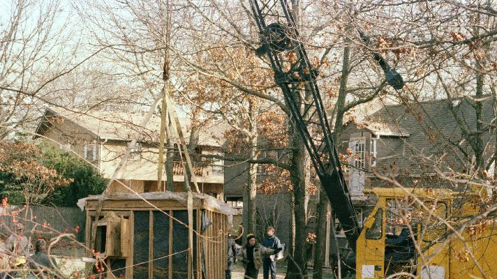 "FILE - In this Jan. 18, 1993 file photo, a crane raises a 6 foot by 9 foot bunker out of the earth from the property of John Esposito in Bay Shore, N.Y. Esposito kept 10-year-old Katie Beers imprisoned for 17 days in the cement and wood bunker, which contains a trap door. On the 20th anniversary of her ordeal, Beers has co-written a book with a television reporter who covered her kidnapping. ""Buried Memories: Katie Beers' Story"" (Title Town Publishing) has a happy ending. (AP Photo/Michael Alexander, File)"