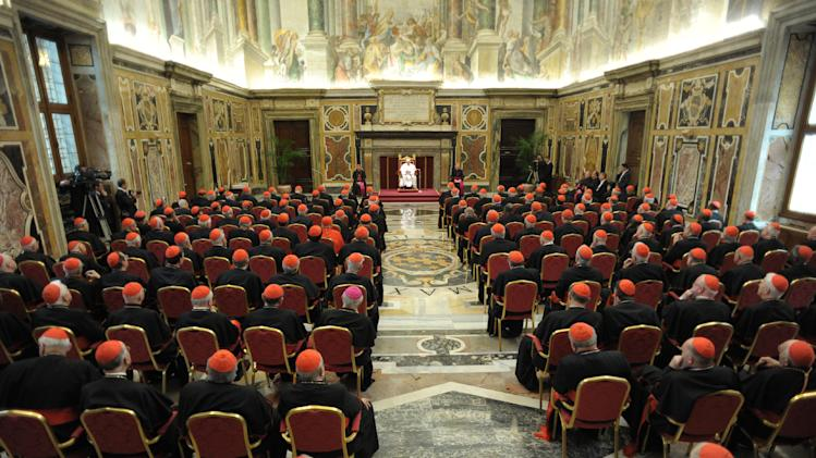 In this photo made available by the Vatican newspaper L'Osservatore Romano, Pope Francis delivers his speech as he meets the Cardinals for the first time after his election, at the Vatican, Friday, March 15, 2013. (AP Photo/L'Osservatore Romano, ho)