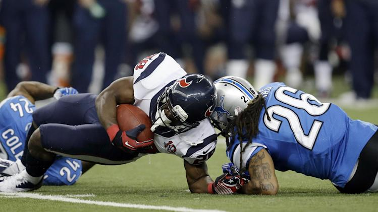Houston Texans running back Justin Forsett (28) is hit by Detroit Lions free safety Louis Delmas (26) during the third quarter of an NFL football game at Ford Field in Detroit, Thursday, Nov. 22, 2012. (AP Photo/Paul Sancya)