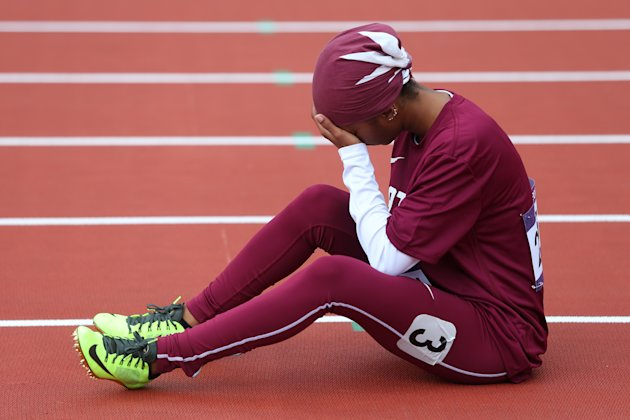 LONDON, ENGLAND - AUGUST 03:  Noor Hussain Al-Malki of Qatar pulls up injured in the Women's 100m Heats on Day 7 of the London 2012 Olympic Games at Olympic Stadium on August 3, 2012 in London, England.  (Photo by Alexander Hassenstein/Getty Images)