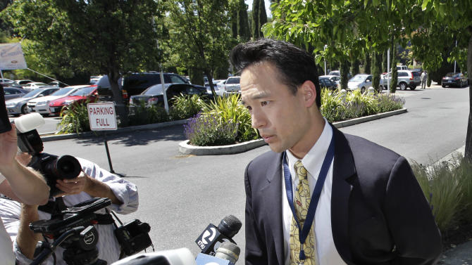 Facebook spokesman Larry Yu talks ot the media during a news conference outside of a hotel in Palo Alto, Calif., Friday, May 11, 2012.  Facebook stock is expected to begin trading publicly on May 18.  (AP Photo/Paul Sakuma)