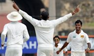 Sri Lankan bowler Nuwan Kulasekara (right) celebrates the dismissal of Pakistan cricketer Younis Khan during the fourth day of the opening Test Match between Sri Lanka and Pakistan in Galle. Kulasekara and Suraj Randiv combined to vanquish Pakistan as Sri Lanka won the first Test by a massive 209 runs, their biggest win over their Asian rivals