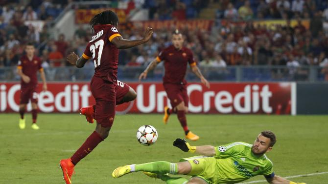 CSKA Moscow's goalkeeper Akinfeev saves a shot from AS Roma's Gervinho during their Champions League Group E soccer match at the Olympic Stadium in Rome