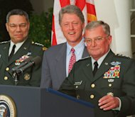 FILE - In this Aug. 11, 1993 file photo, Army Gen. John Shalikashvili speaks in the Rose Garden of the White House in Washington accompanied by President Bill Clinton and Joint Chiefs Chairman Gen. Colin Powell. On Saturday, July 23, 2011, the White House said Retired Gen. Shalikashvili, former chairman of the Joint Chiefs of Staff, has died. (AP Photo/Doug Mills, File)