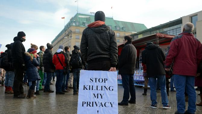Demonstrators protest against data preservation in front of the US embassy in Berlin on February 1, 2014