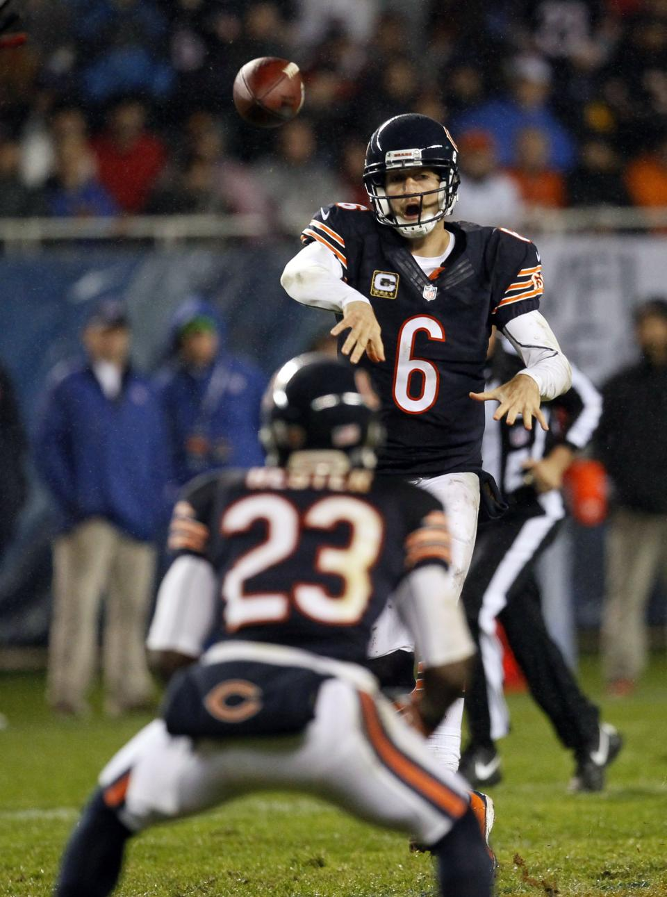 Chicago Bears quarterback Jay Cutler (6) throws an illegal forward pass to wide receiver Devin Hester (23) in the first half an NFL football game in Chicago, Sunday, Nov. 11, 2012.  The Texans won 13-6. (AP Photo/Charles Rex Arbogast)