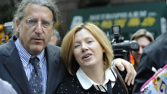 Anna Gristina exits Manhattan criminal court with her attorney Norman Pattis, left, Tuesday, Sept. 25, 2012, in New York.  The suburban mother of four charged with moonlighting as a multimillion-dollar madam pleaded guilty Tuesday to promoting prostitution.The Scotland-born Anna Gristina made the plea in Manhattan court. The judge said she'll be sentenced Nov. 20 to time served and probation as part of a plea deal. (AP Photo/ Louis Lanzano)