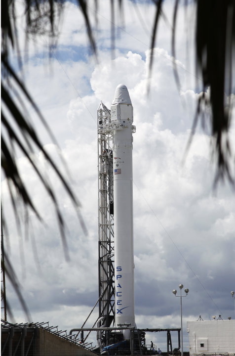 The Falcon 9 SpaceX rocket stands on space launch complex 40 ready for launch at the Cape Canaveral Air Force Station in Cape Canaveral, Fla. on Sunday, Oct. 7, 2012. Launch is scheduled for 8:35 PM S
