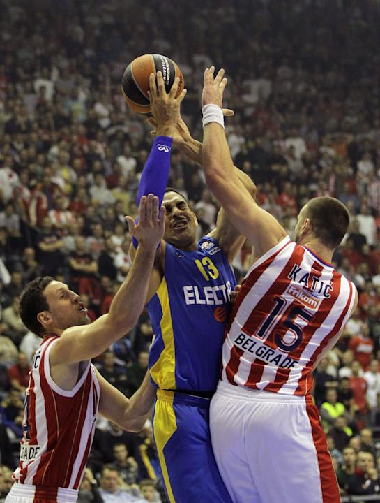 David Blu of Maccabi Electra Tel Aviv, center, challenges for the ball with Red Star's Ivan Radenovic, left and Rasko Katic during their Round 7, Group D, Euroleague basketball match in Belgrade, Serb