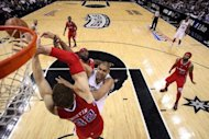 Tim Duncan of the San Antonio Spurs takes a shot against Blake Griffin of the Los Angeles Clippers in Game Two of the Western Conference Semifinals of the 2012 NBA Playoffs at AT&T Center, on May 17, in San Antonio, Texas. The Spurs won 105-88, extending their series lead to 2-0