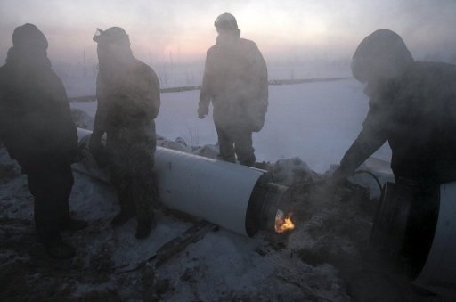 <p>File picture shows workers at a gas pipeline in Novy Urengoi, just below the arctic circle in far northern Russia. From falling profits to an EU anti-trust probe and a possibly misguided strategy based on pipelines -- storm clouds are finally gathering over Russia's previously invincible gas giant Gazprom.</p>