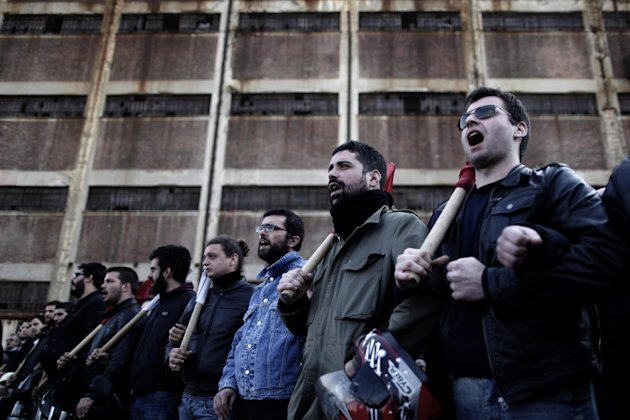 Members of a Communist Party-affiliated union demonstrate in solidarity for mobilized ferry crews at Piraeus, the port of Athens, on Wednesday, Feb. 6, 2013. Greece's conservative-led government used
